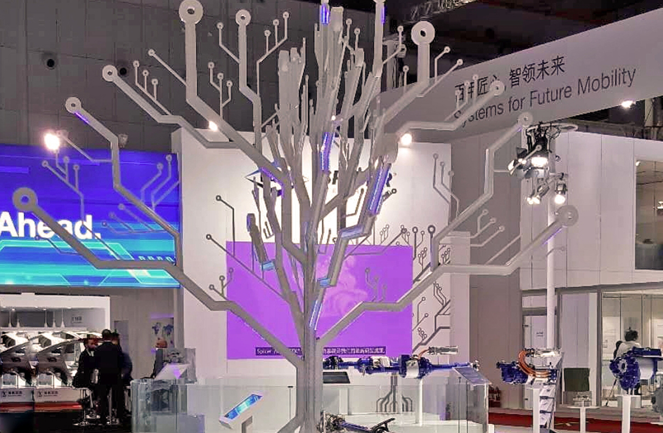 Conducting paths symbolized by a white tree with many different branches shows the linkage of IoT and autonomous driving. The international leading fair Auto Shanghai offers innovative exhibition spaces for more than 1.000 automotive manufacturers and suppliers at the Shanghai New International Expo Centre.