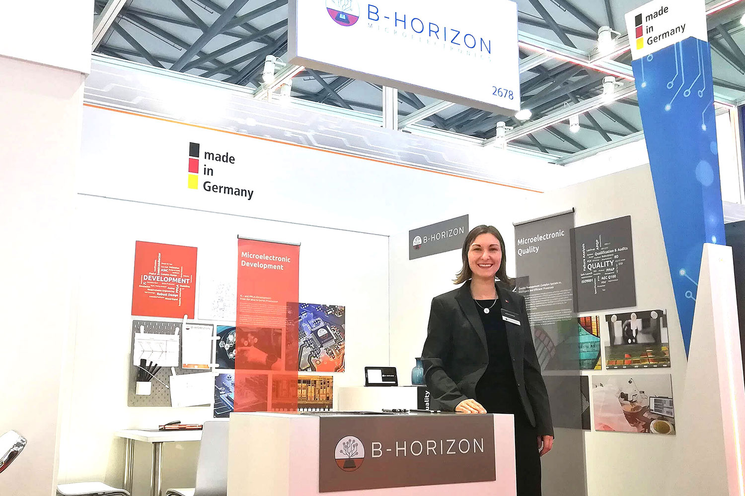 Helena Krämer (Executive Management Assistant) at B-Horizon's booth at the SEMICON China, which reflects the three fundamental pillars of the business model: Microelectronic development, quality management and consulting.