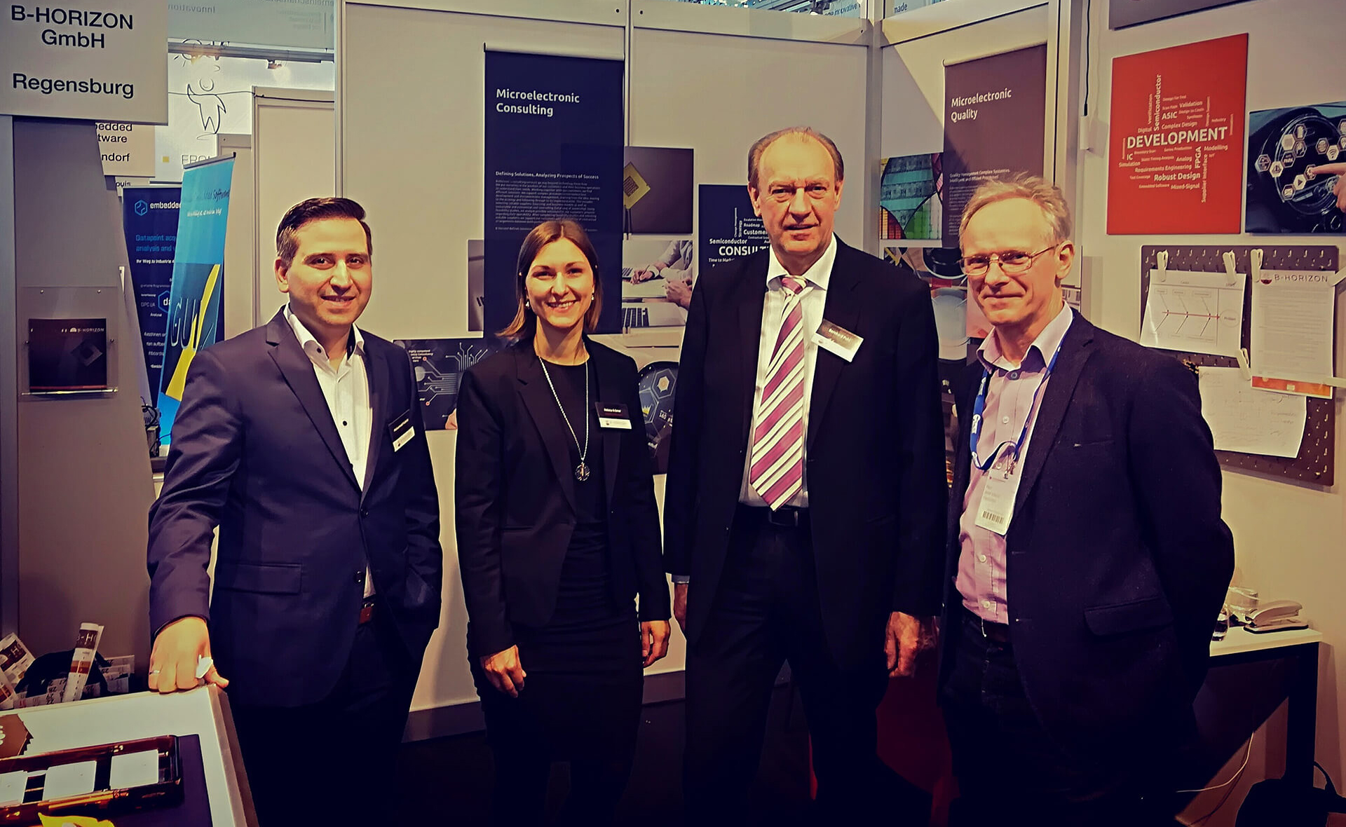 Group photo with founder and CEO Mohammad Kabany, Helena Krämer (Executive Management Assistant), Bernhard Pohl (Head of Quality Management) and Josef Schmid (Engineer at iSyst Intelligente Systeme GmbH) in front of their booth at the Embedded World in Nürnberg. B-Horizon's team presented their future-oriented business model in the growth market of the microelectronic industry to about 31.000 visitors.
